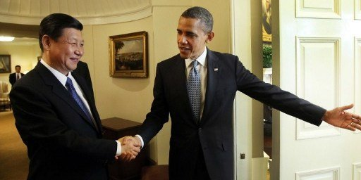 Deux candidats, deux super-puissances. (© AFP PHOTO/XINHUA/LAN HONGGUANG)