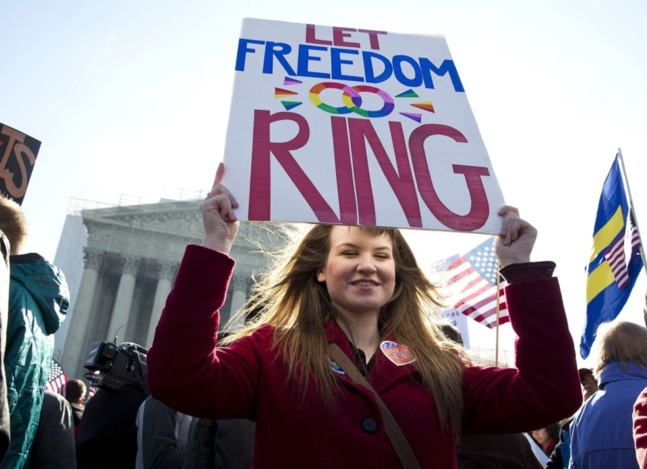 A supporter of gay marriage holds a sign in front of the Supreme Court in Washington March 27, 2013. (Joshua Roberts/Reuters)
