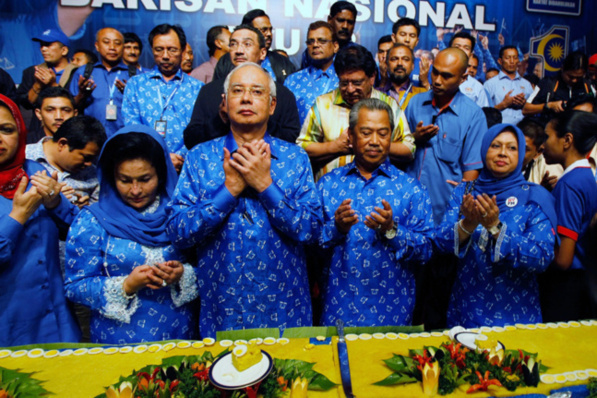 Malaysia's Prime Minister Najib Razak (second from left) celebrates his victory with a prayer on election day in Kuala Lumpur, Malaysia. Photo -- Nicky Loh/Getty Images