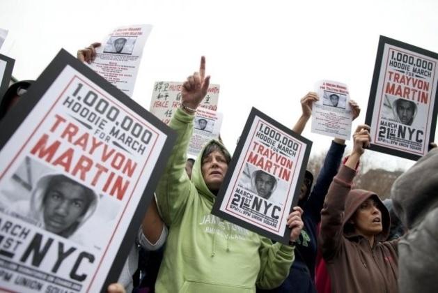 Photo : Andrew Burton, REUTERS || New York durant l'une des nombreuses manifestations organisées pour défendre Trayvon Martin contre l'impunité de son bourreau, Georges Zimmerman.