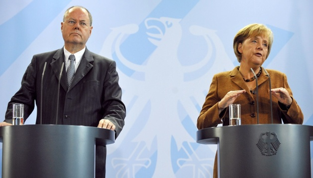Peer Steinbrück (SPD) and Angela Merkel (CDU) | Credit Photo -- picture alliance
