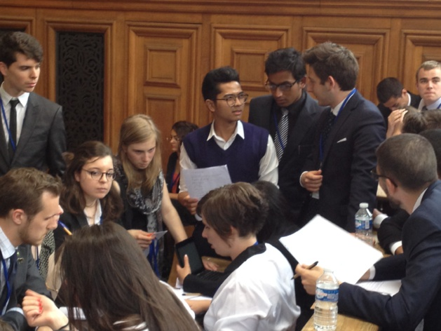The delegates working on theirs resolutions.