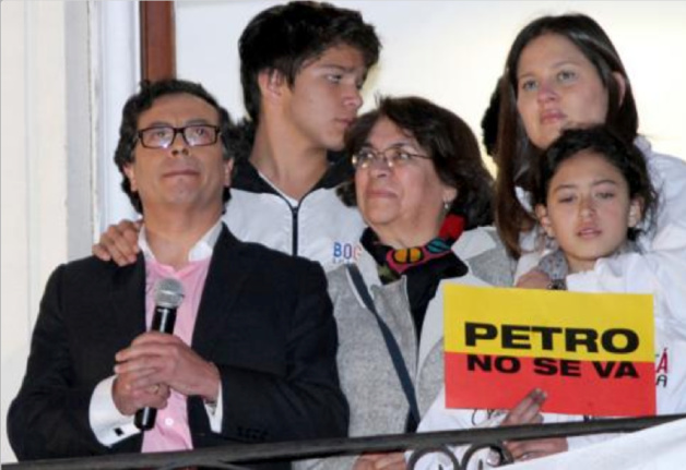 Petro and his family standing at the balcony of the town hall of Bogota, addressing his supporters © AFP